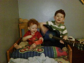 Boys on bed with guitar